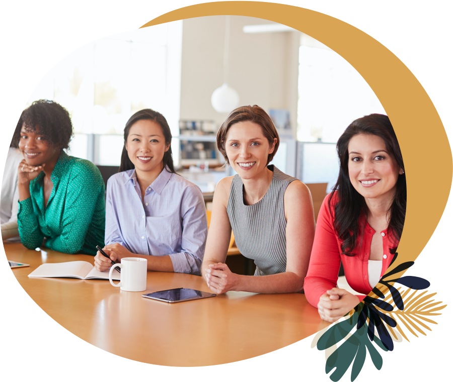 Four happy women at a conference table