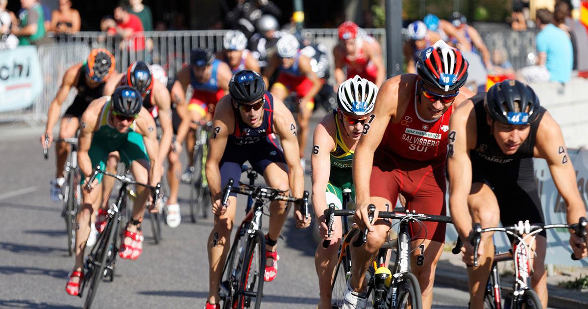 Triathletes on bicycles.