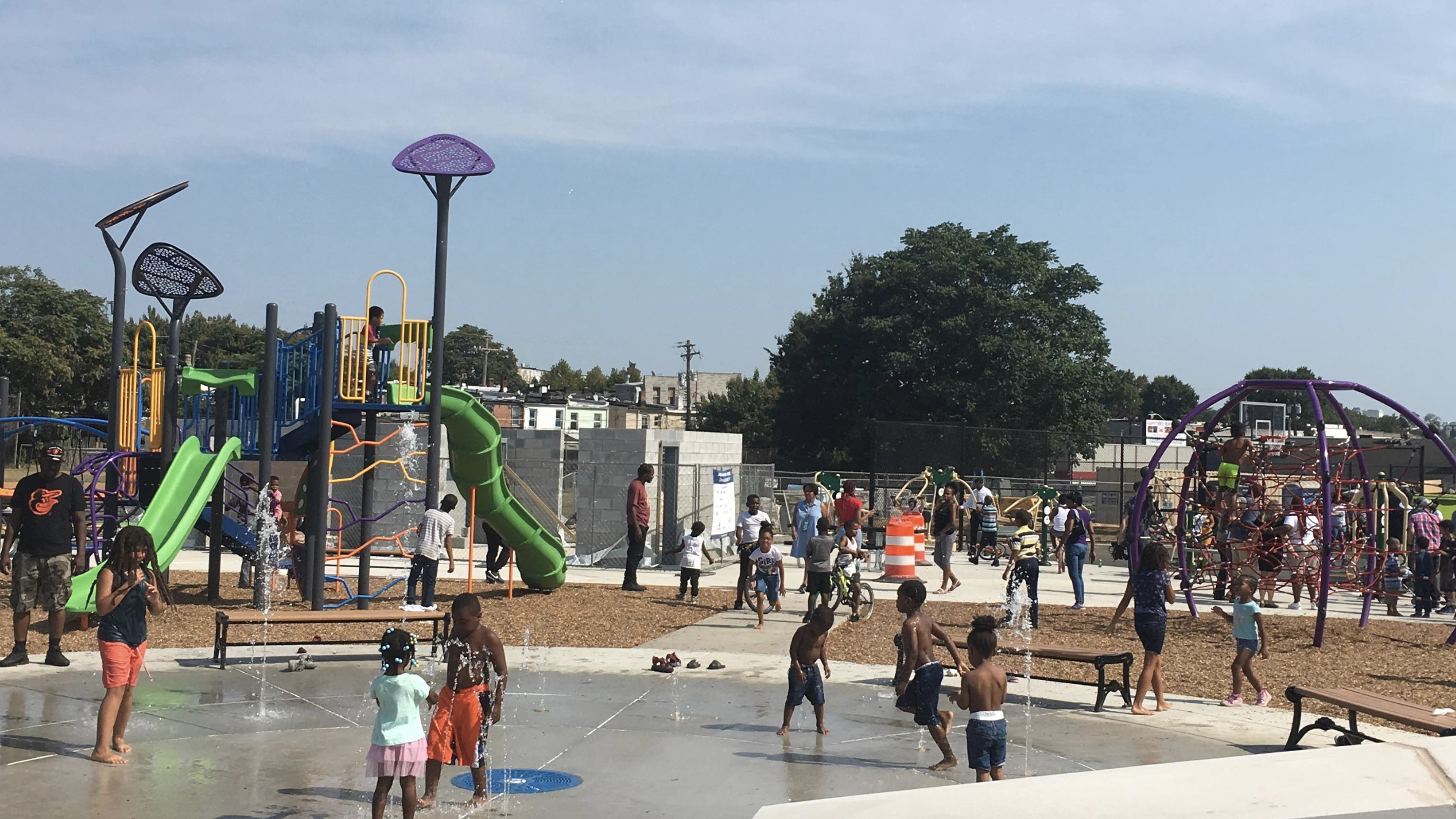 Kids and community members play at the newly renovated Catherine Street Park in Baltimore.