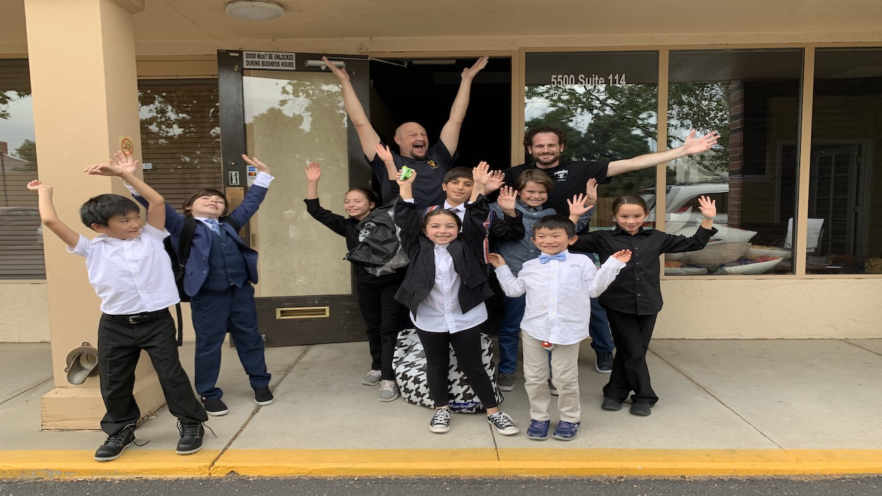 Students celebrate in front of Sol Acting Studios