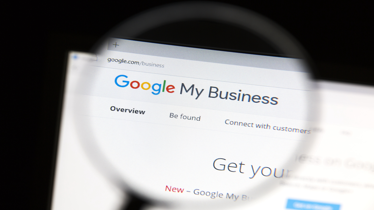 Screen shot of Google My Business being magnified by magnifying glass.