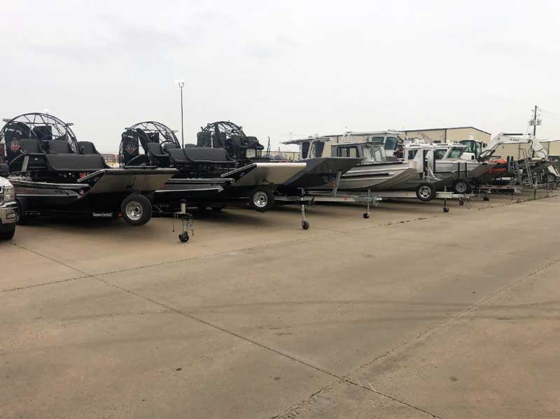 row of boats with marine equipment