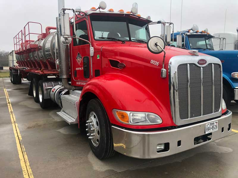 red 18-wheeler with vacuum