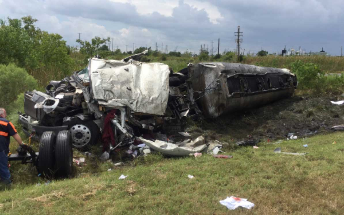 18-wheeler destroyed by fire and turned on its side