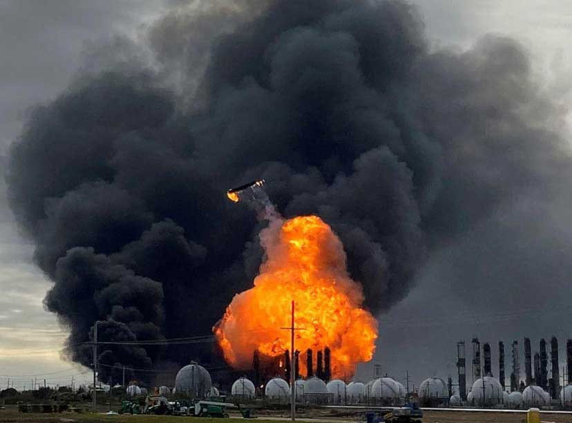 chemical plant on fire with big cloud of smoke