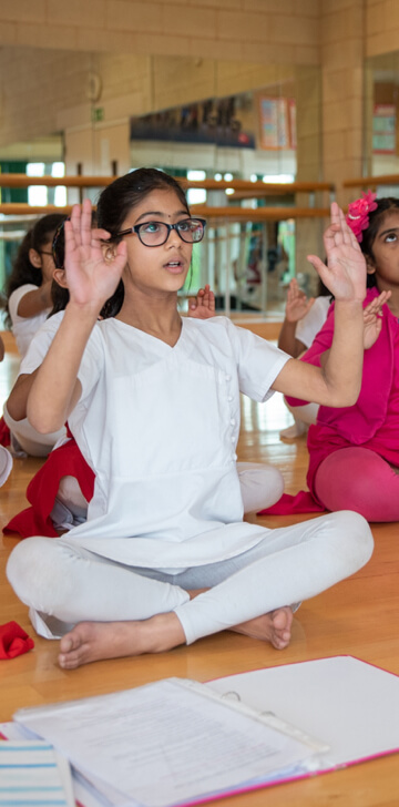 a young chitraleka dance student sitting in class