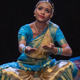 chitraleka dance academy dancer emotes on stage
