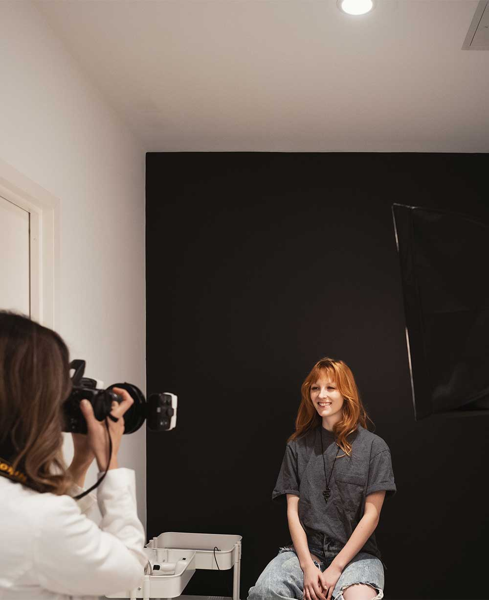 Photo of a patient getting her photo taken