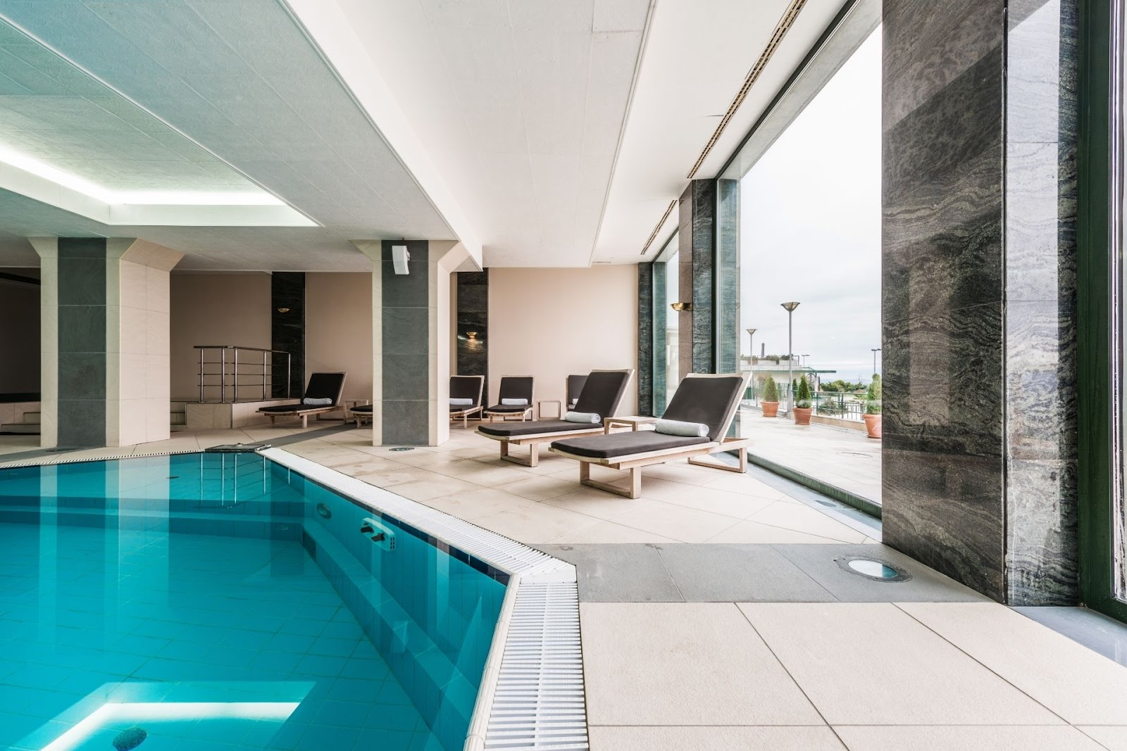 chairs by a luxury swimming pool