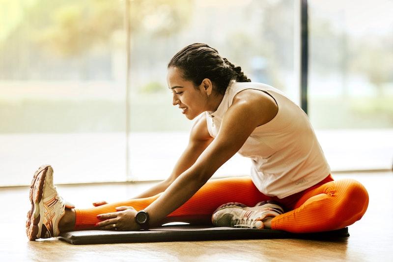 gym sitting on floor stretching