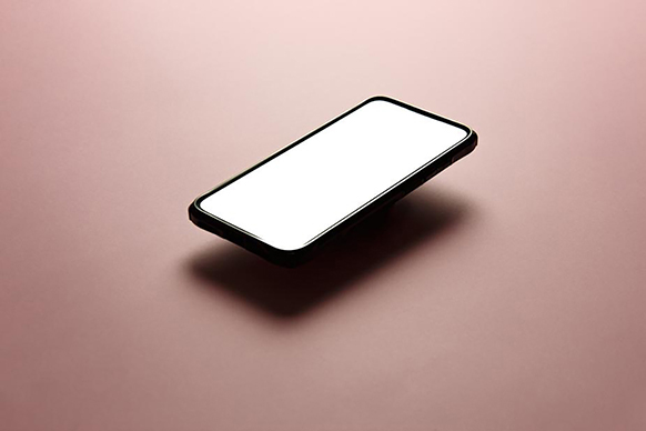 Cell phone floating over black background
