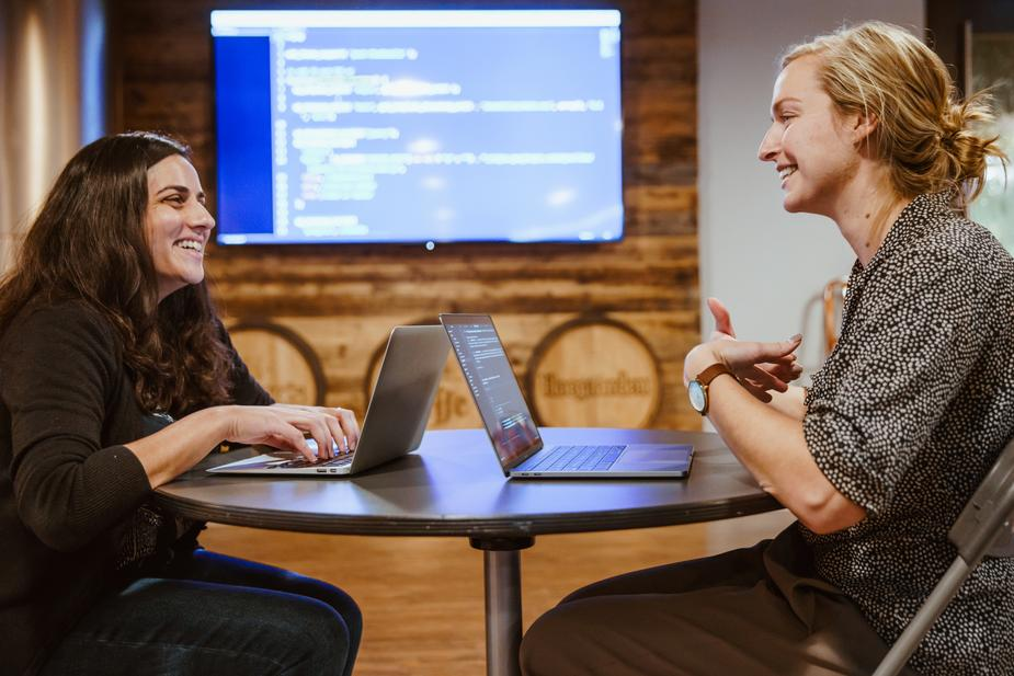 Two people learning how to code