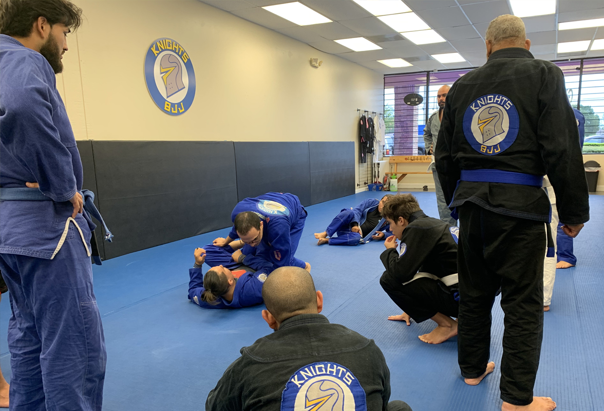 Students of knights bjj watching Pedro demonstrate a technique. .
