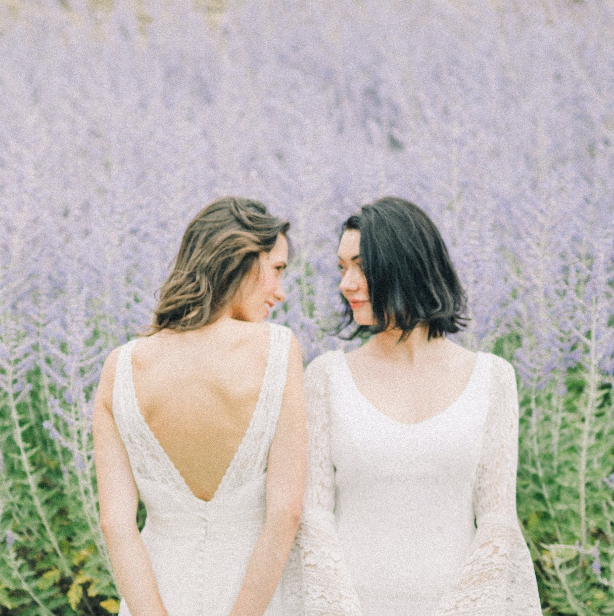 Two women in front of a field of lavender.
