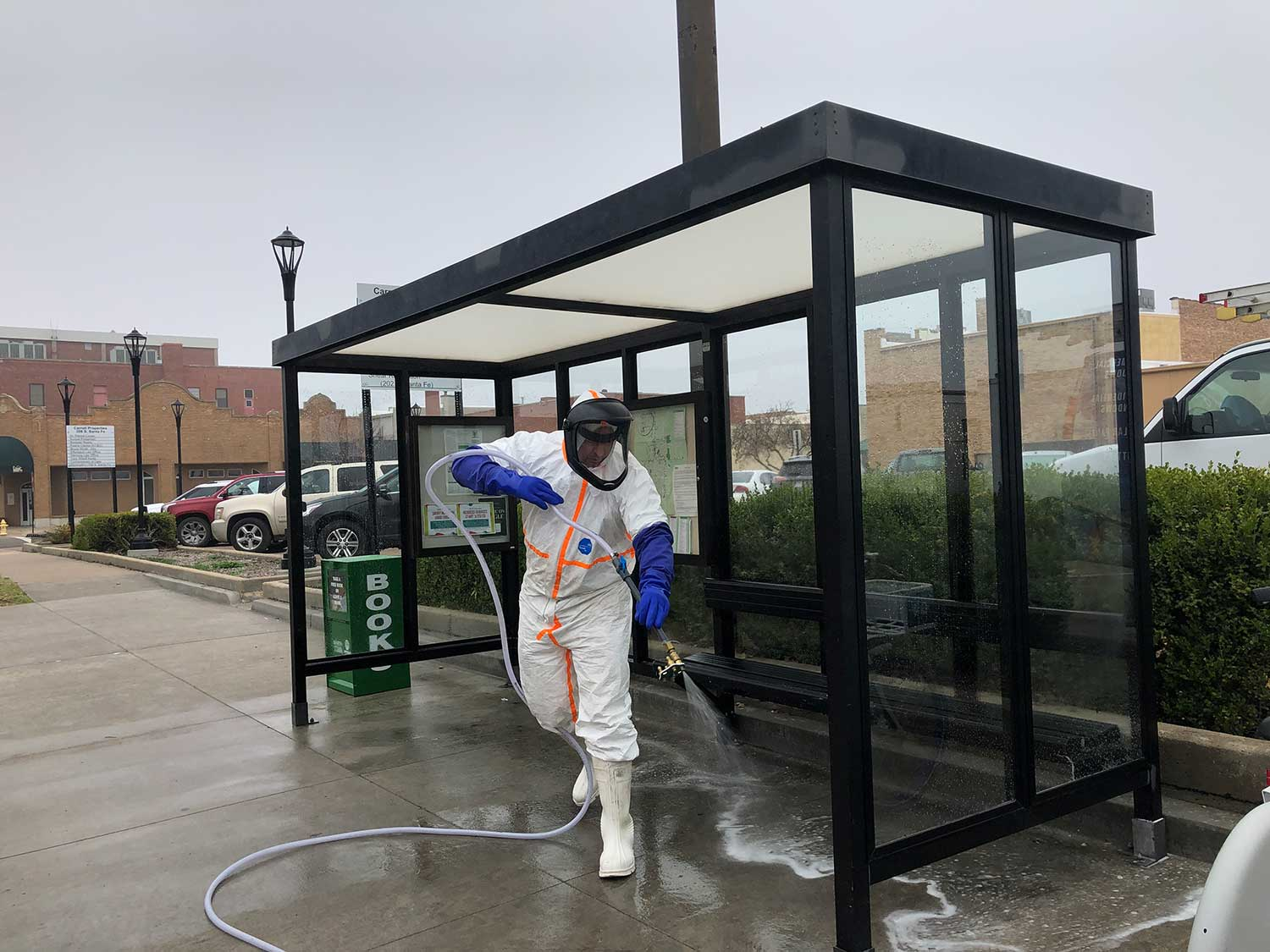 Advantage SOFTWASH sanitizing a bus stop