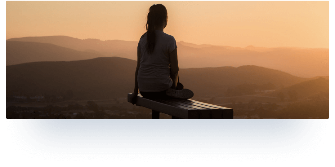 Girl meditates seeing off the sunset
