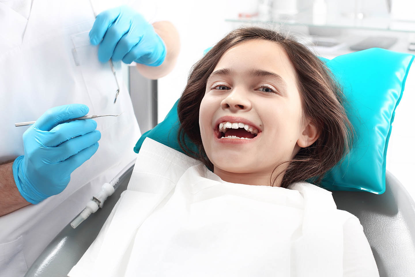 young girl smiling at the dentist office