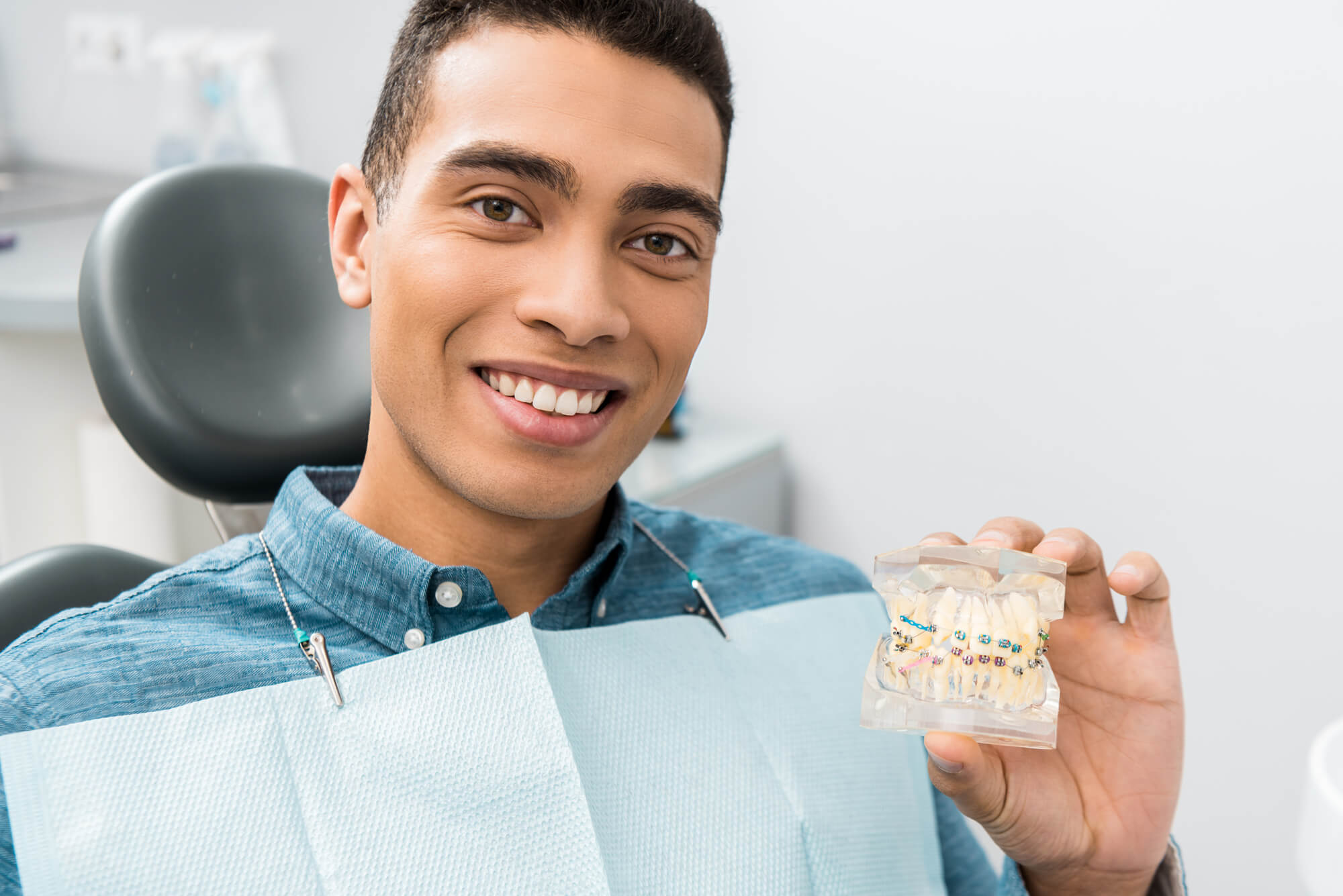 Handsome man after getting braces in hollywood removed