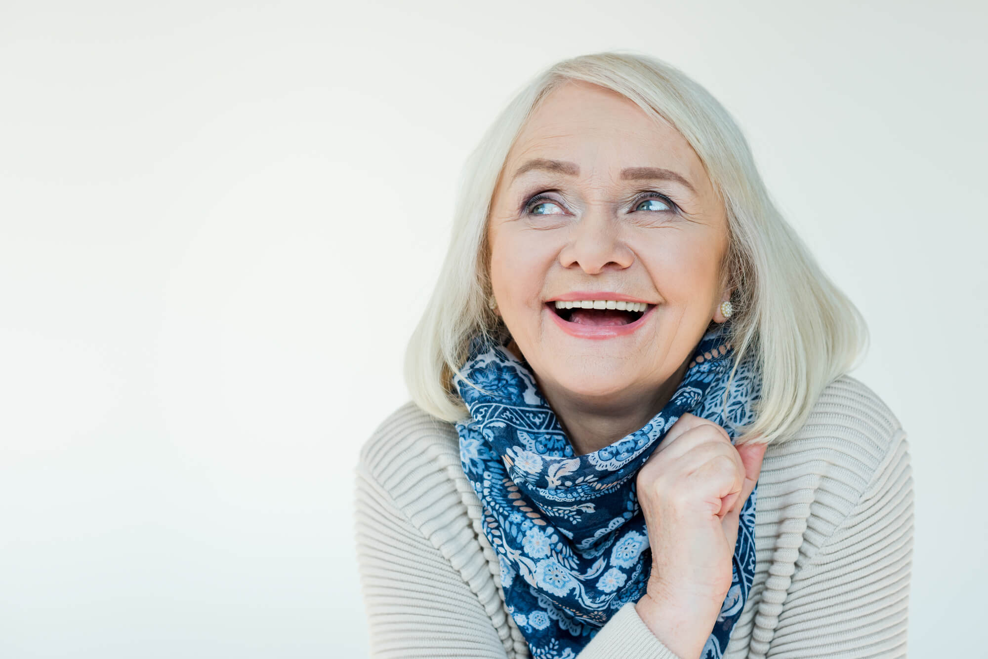 woman with dental implants coral springs