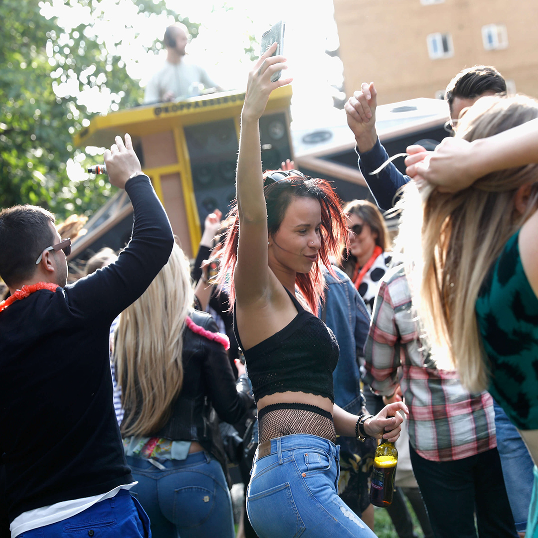 Young woman dancing to the Kopparberg brand activation.