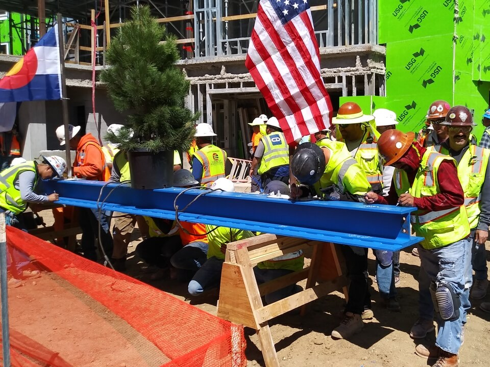 Midwest Partitions steel beam signing