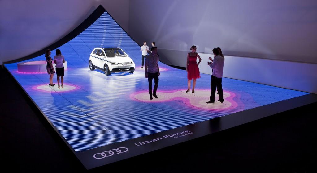 Audi's self-driving car driving between attendees.