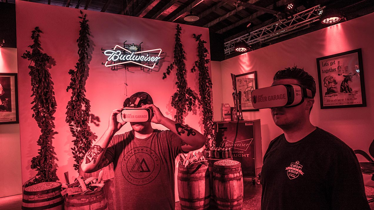 Two event attendees experiencing Budweiser's VR brewery tour.