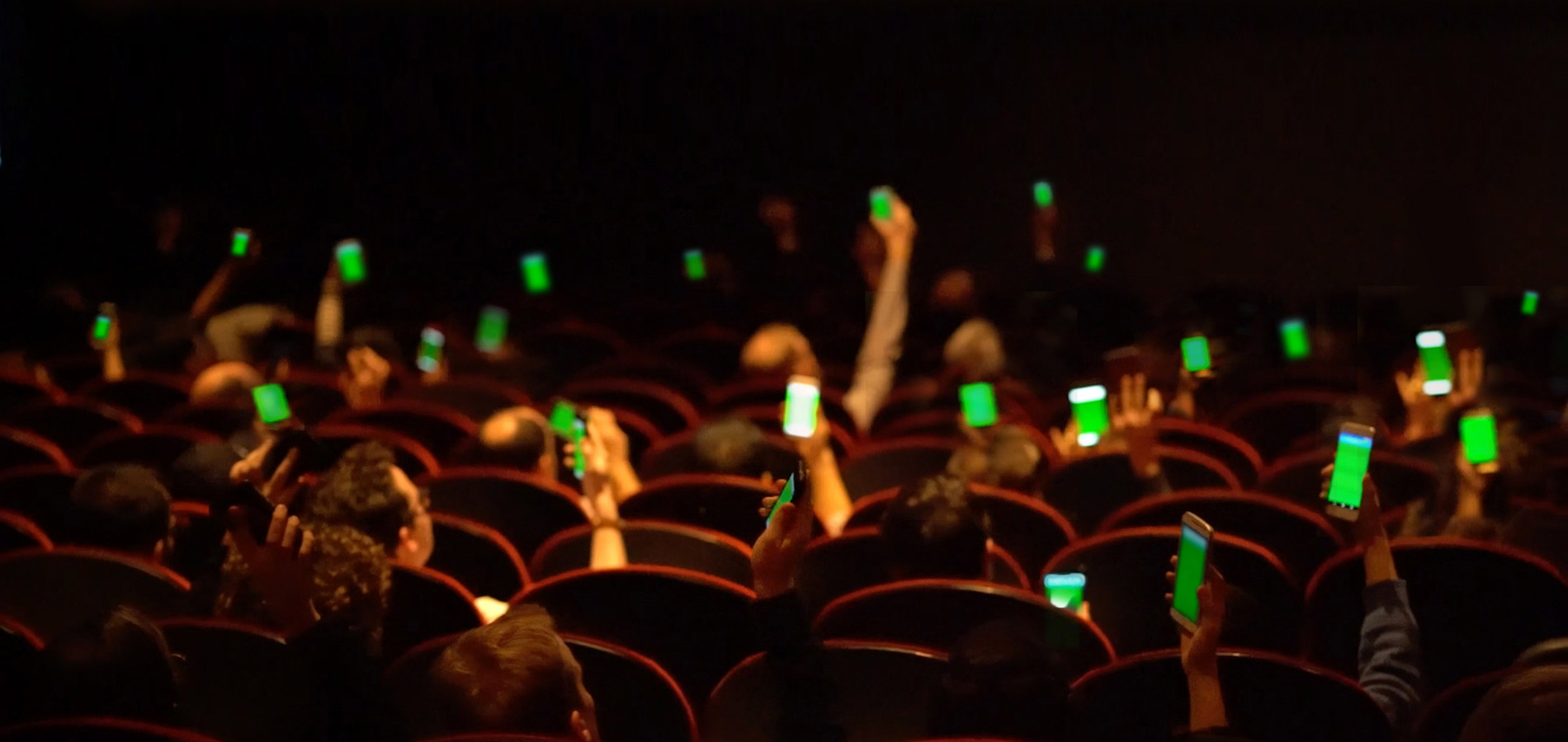 Apps lighting up according to how the audience answers polling questions.