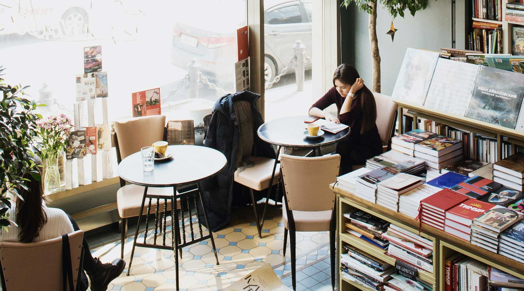 Women focused on work at a cafe.