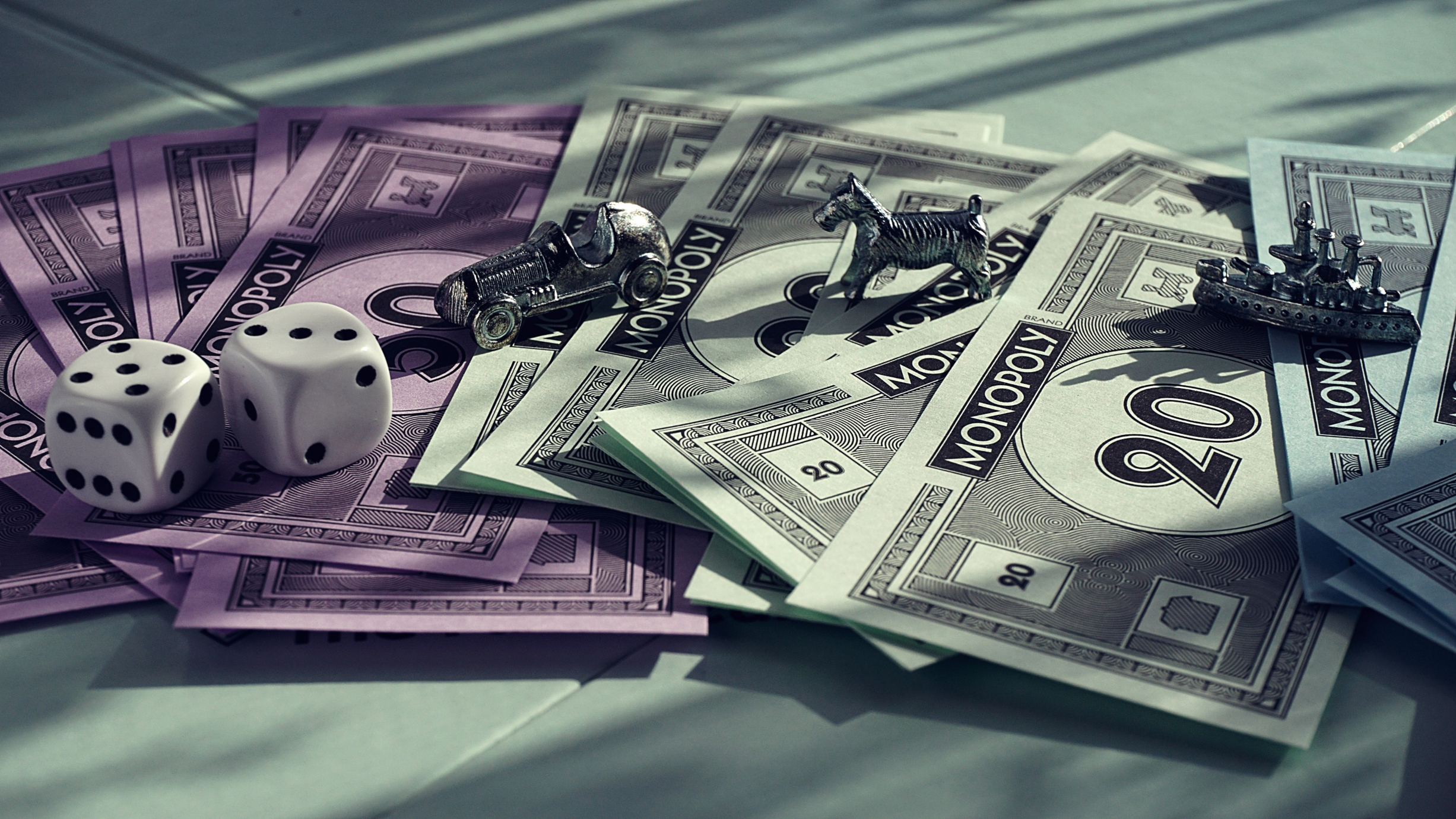 Monopoly board and cash | Photo by Suzy Hazelwood from Pexels