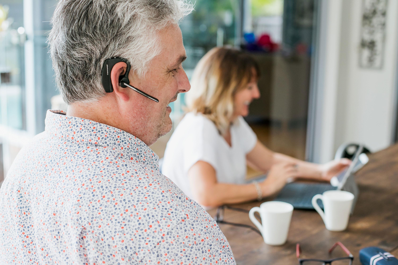 Man wearing in-ear assistive technology