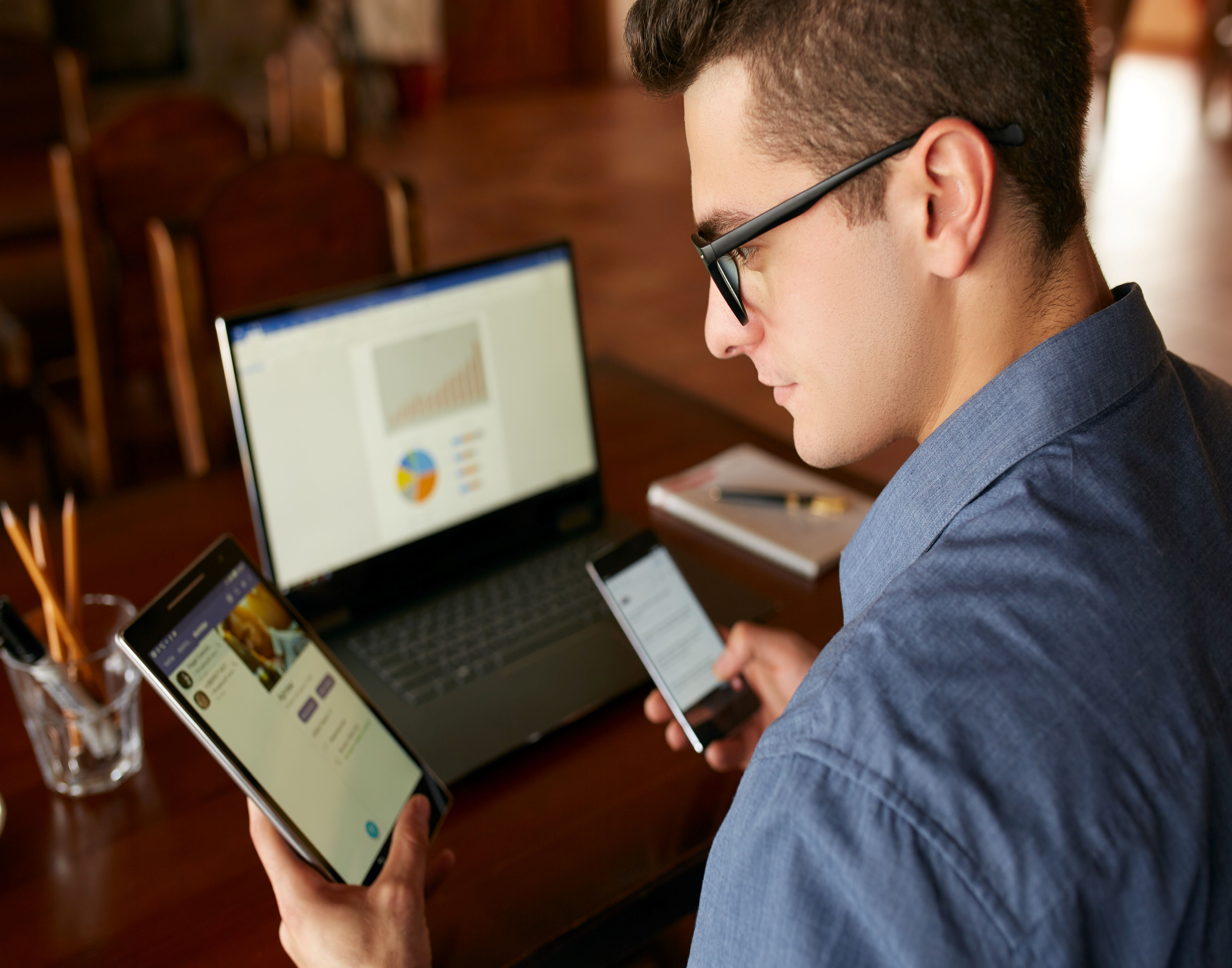 Man using multiple devices at work