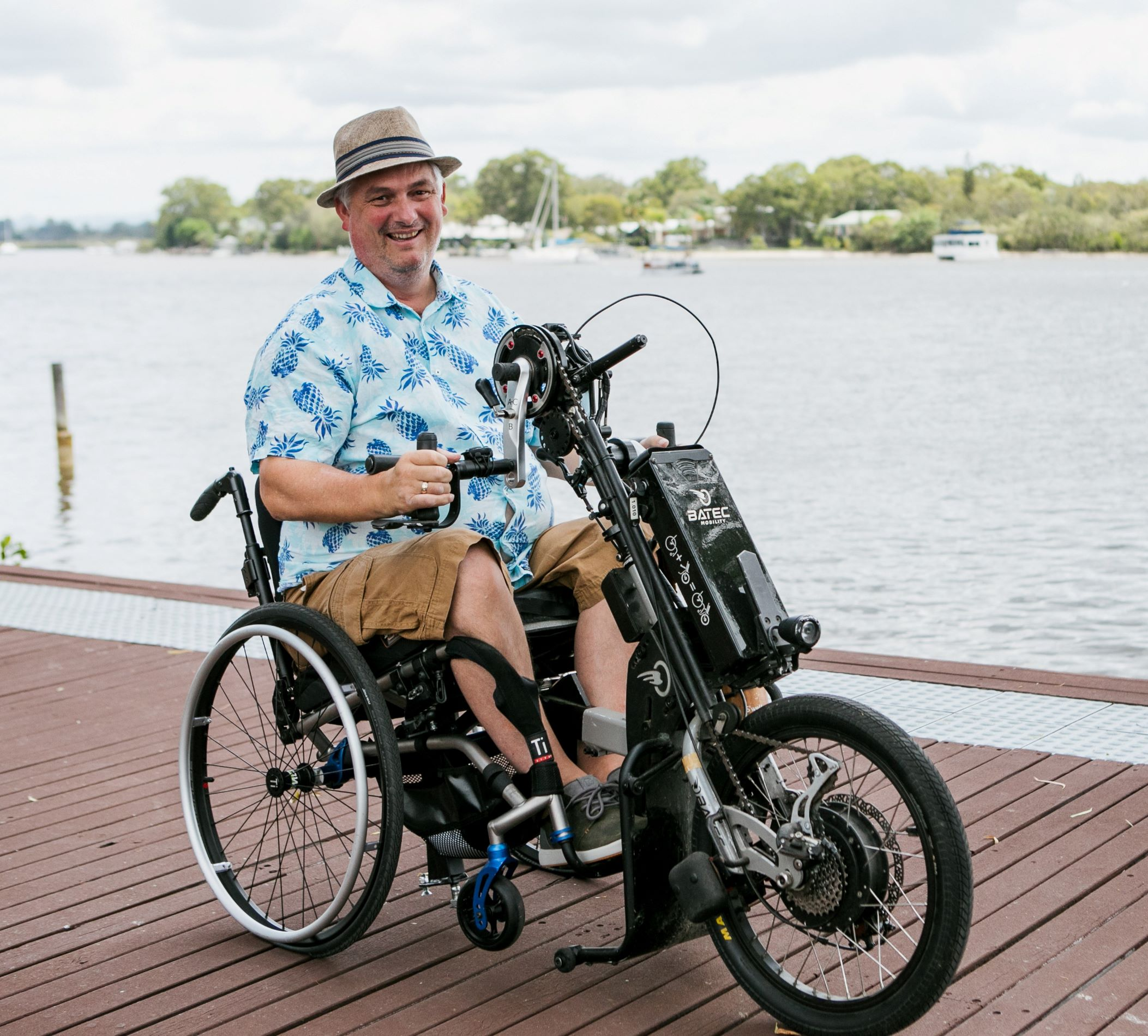 man in a wheelchair with bike attachement