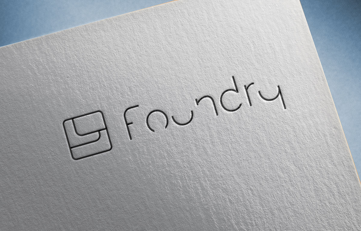 foundry custom logo design white paper pressed