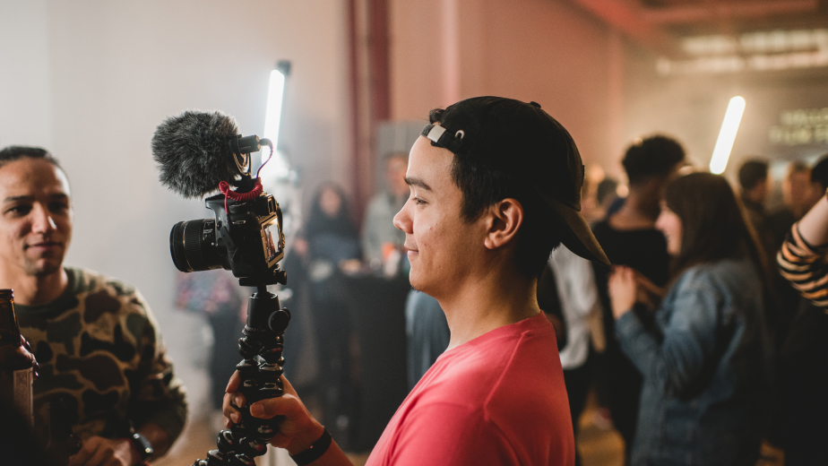 Person filming on a DSLR video rig