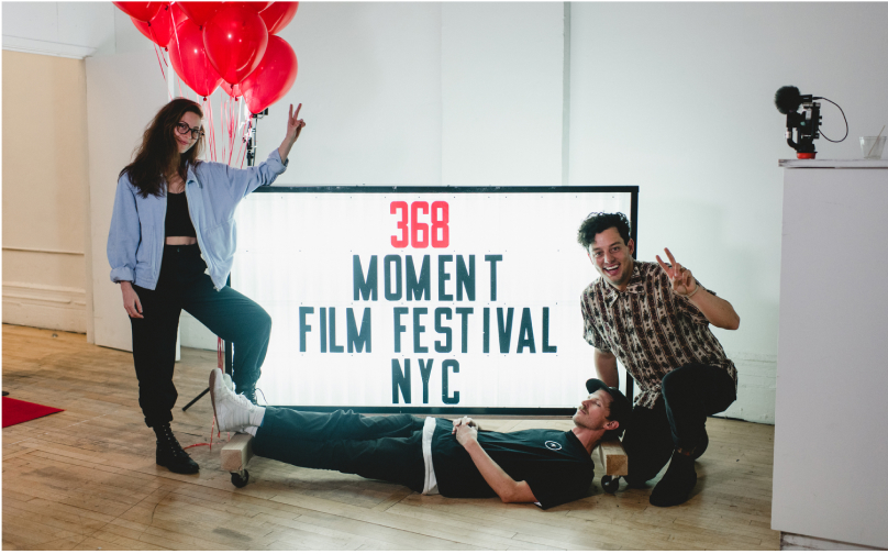 Taylor, Caleb, and Niles in front of a MIFF 2019 sign