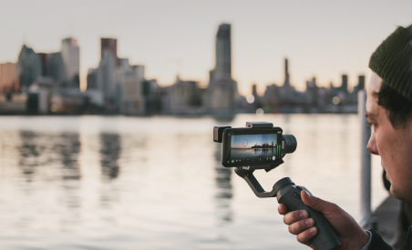 Niles filming on a mobile device using a gimbal