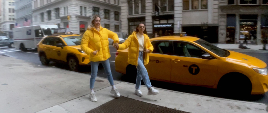 Two people wearing yellow jackets in New York City