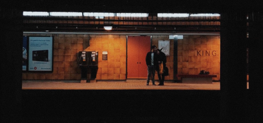 Screen grab of a film — two people on a train platform
