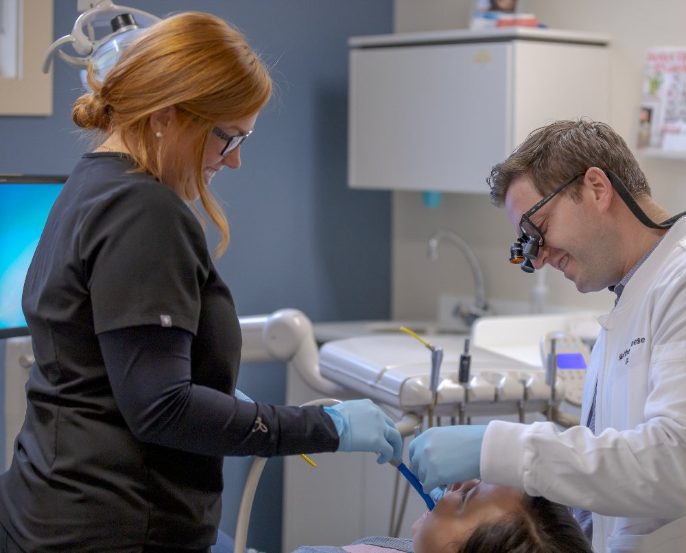 patient receiving a teeth cleaning