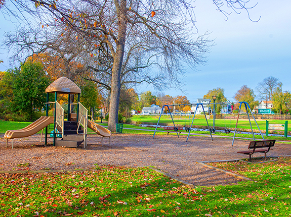Children's playground in Brookside Park featuring slides and swings