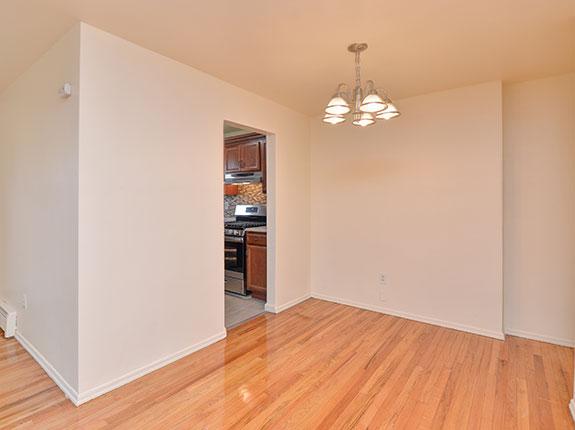 Empty dining room featuring shiny hardwood floors