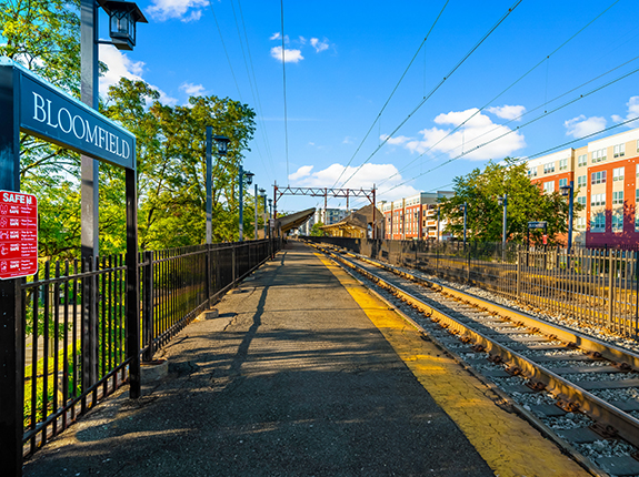 Bloomfield train stand with view of tracks and buildings