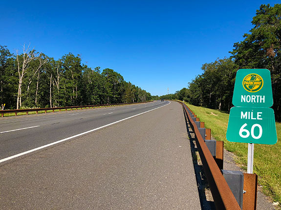 Garden State Parkway with mile marker sign and logo