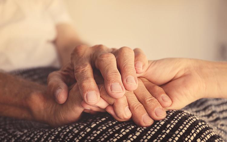 A closeup picture of a patient's hands