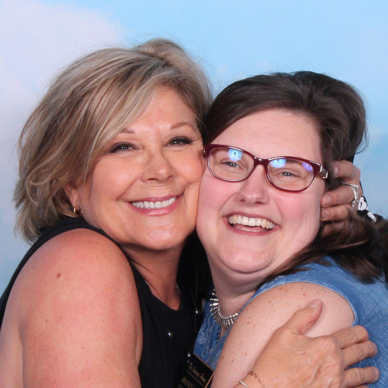 Board members from the Journey Home hugging at the Denim And Diamonds fundraiser