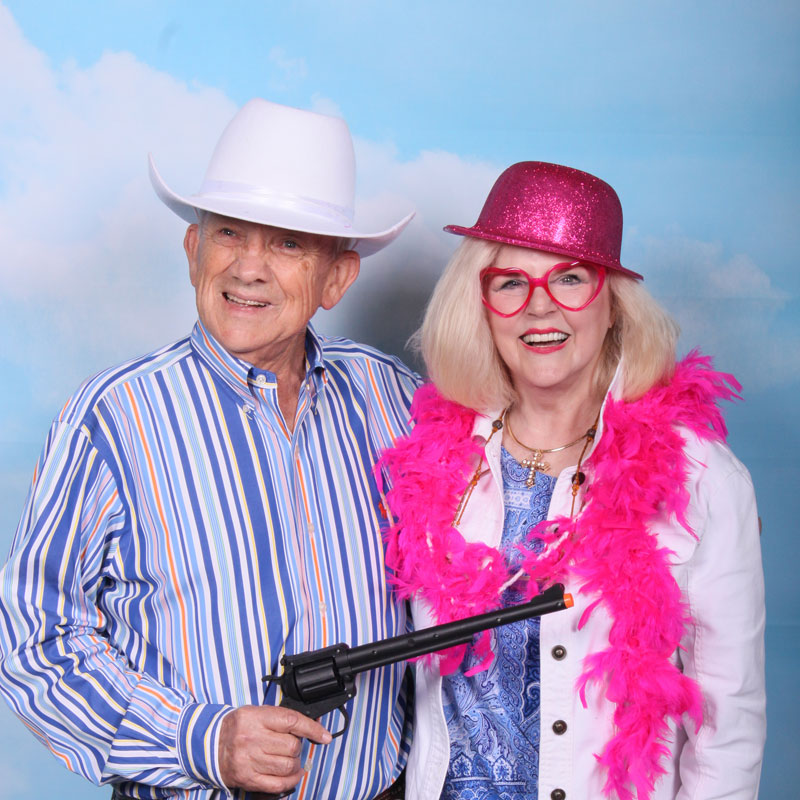 Board members having fun in the photo booth at Denim and Diamonds
