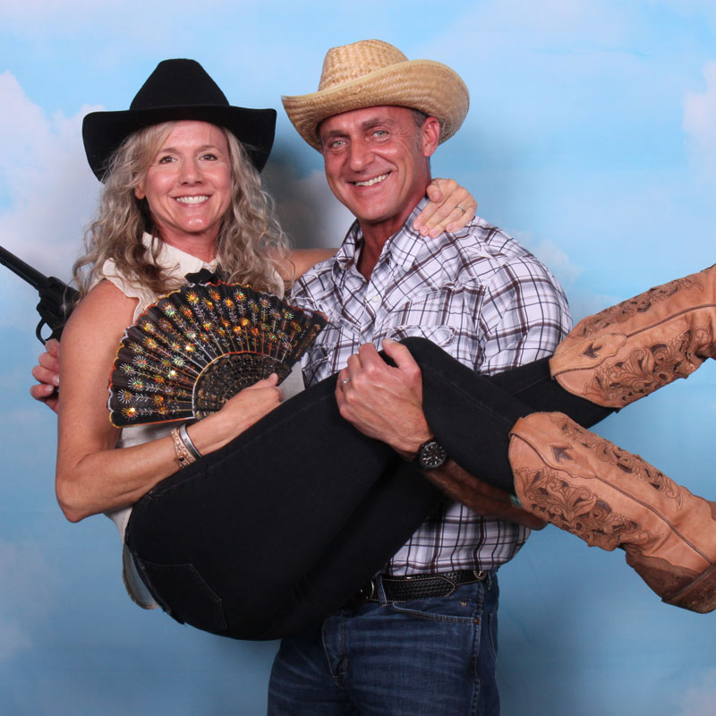 A couple having fun in the photo booth at Denim And Diamonds