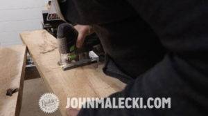 john malecki cuts wood panels for his french doors