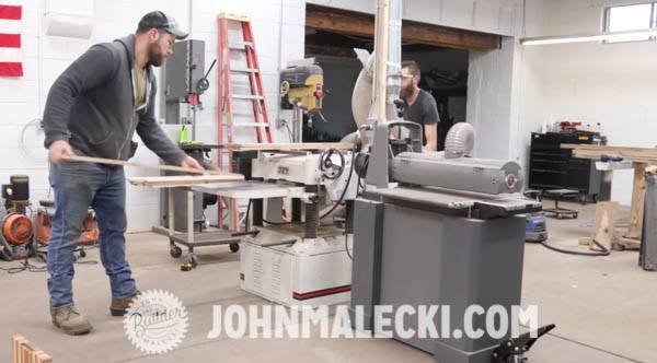 John Malecki saws his DIY door panels